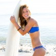 Beautiful surfer teen girl with surfboard on beach — Stock Photo