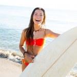 Brunette teenager surfer bikini girl with surfboard — Stock Photo