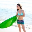 Surf girl with surfboard in beach shore — Stock Photo