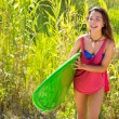 Brunette surfer girl walking in the jungle — Stock Photo