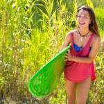 Brunette surfer girl walking in the jungle — Stock Photo #30642495
