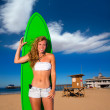 Blond surfer teen girl holding surfboard on beach — Stock Photo