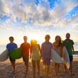 Surfers boys and girls group walking on beach — Foto de Stock