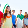 Teenager surfers boys and girls group happy — Stock Photo