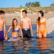 Happy beautiful teen surfers enjoying on beach — Stock Photo