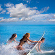 Boys and girls teen surfers surfing on surfboards — Stock Photo