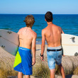 Boys teen surfers rear view looking at beach — Stock Photo
