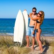 Teen surfers couple hug on the beach — Stock Photo
