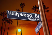 Hollywood Boulevard with Vine sign illustration on palm trees — Stock Photo