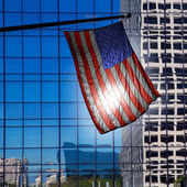 US american symbol flag over blue modern LA buildings — Stock Photo