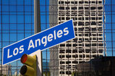 LA Los Angeles downtown wit road sign photo mount — Stock Photo