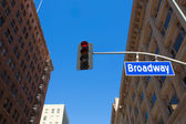 Broadway street Los Angeles Road sign in redlight — Stock Photo