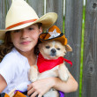 Beautiful cowboy kid girl holding chihuahua with sheriff hat — Stock Photo
