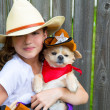 Beautiful cowboy kid girl holding chihuahua with sheriff hat — Stock Photo #32487783