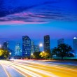 Houston Texas skyline at sunset with traffic lights — Stock Photo #32488407