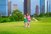 Two sister girls friends walking in urban skyline — Stock Photo