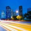 Houston Texas skyline at sunset with traffic lights — Stock Photo