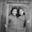 Twin girls fancy dressed up pretending be siamese in frame — Stock Photo