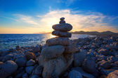 Ibiza Cap des Falco beach sunset with desire stones — Stock Photo