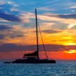 Ibiza san Antonio Abad catamaran sailboat sunset — Stock Photo
