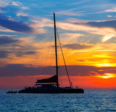 Ibiza san Antonio Abad catamaran sailboat sunset — Stock Photo