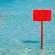 Turquoise tropical sea with red sign blank copyspace — Stock Photo