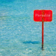 Turquoise tropical sea with red sign saying Paradise — Stock Photo