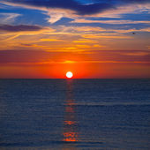 Sunset at Mediterranean sea with orange sky — Stock Photo