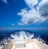 Fishing boat stern deck with trolling fishing rods and reels — Stock Photo