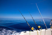 Ibiza fishing boat trolling rods and reels in blue sea — Stock Photo