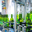 White wine in bottling machine at winery — Stock Photo