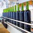Red wine in bottling machine at winery — Stock Photo #34422119