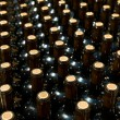 Wine bottles in a row as a pattern with cork  — Stock Photo
