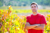 Harvester winemaker farmer proud of his vineyard — Stock Photo