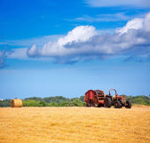 Menorca combine tractor wheat with round bales — Stock Photo