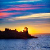 Menorca sunset in Cala Morell at Ses torretes beach — Stock Photo