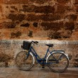 Bicycle in historical Ciutadellstone wall at Balearics — Stock Photo #35165667