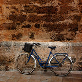 Bicycle in historical Ciutadella stone wall at Balearics — Stock Photo