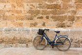 Bicycle in historical Ciutadella stone wall at Balearics — Stock Photo