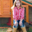 Breeder hens kid girl rancher farmer sitting in chicken tractor — Stock Photo