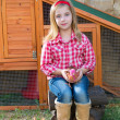Breeder hens kid girl rancher farmer with chicks in chicken coop — Stock Photo #35693079