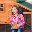 Breeder hens kid girl rancher farmer with chicks in chicken coop — Stock Photo #35693353