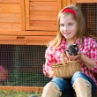 Breeder hens kid girl rancher farmer with chicks in chicken coop — Stock Photo #35694037