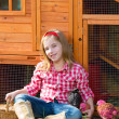 Breeder hens kid girl rancher farmer with chicks in chicken coop — Stock Photo #35694513