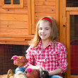 Breeder hens kid girl rancher farmer with chicks in chicken coop — Stock Photo #35694677