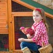 Breeder hens kid girl rancher farmer with chicks in chicken coop — Stock Photo #35694939