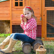 Breeder hens kid girl rancher farmer with chicks in chicken coop — Stock Photo #35695767