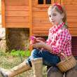 Breeder hens kid girl rancher farmer with chicks in chicken coop — Stock Photo #35695979