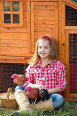 Breeder hens kid girl rancher farmer with chicks in chicken coop — Foto Stock