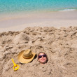 Stock Photo: Funny girl playing buried in beach sand smiling sunglasses